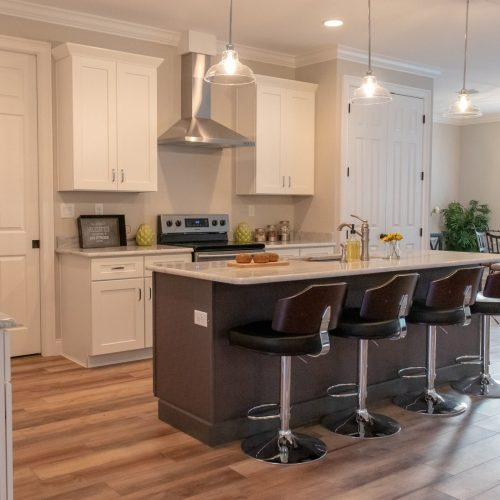 kitchen with island countertop and dining stools