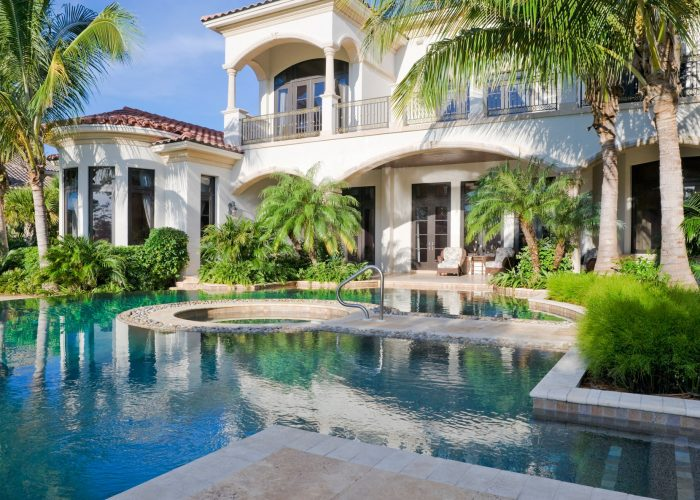 Mediterranean style home with luxury pool area