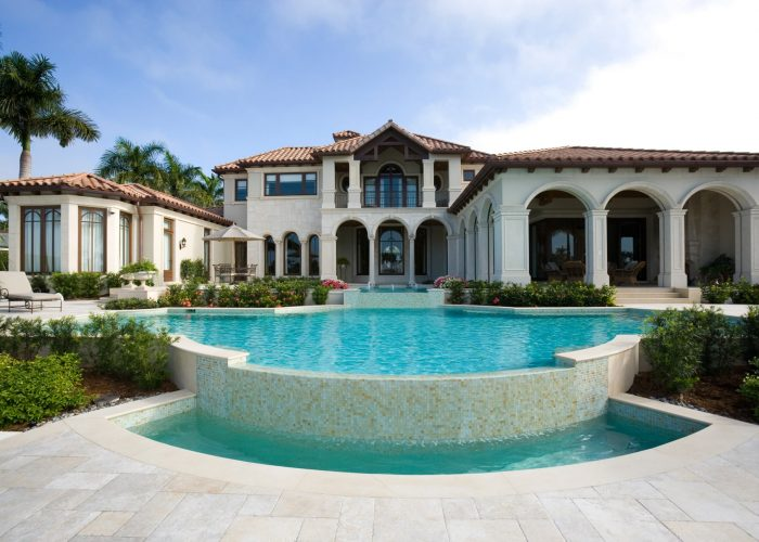 Mediterranean style luxury home with cascading pool and spa area
